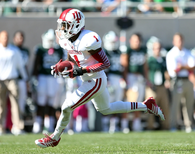 Oct 12, 2013; East Lansing, MI, USA; Indiana Hoosiers wide receiver Shane Wynn (1) runs for extra yards after the catch against Michigan State Spartans defense during the second half in a game at Spartan Stadium. MSU won 42-28. Mandatory Credit: Mike Carter-USA TODAY Sports