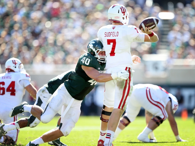 Oct 12, 2013; East Lansing, MI, USA; Michigan State Spartans linebacker Max Bullough (40) sacks Indiana Hoosiers quarterback Nate Sudfeld (7) during the second half in a game at Spartan Stadium. MSU won 42-28. Mandatory Credit: Mike Carter-USA TODAY Sports