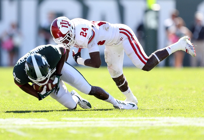 Oct 12, 2013; East Lansing, MI, USA; Michigan State Spartans wide receiver Keith Mumphery (25) makes a catch against Indiana Hoosiers cornerback Tim Bennett (24) during the second half in a game at Spartan Stadium. MSU won 42-28. Mandatory Credit: Mike Carter-USA TODAY Sports