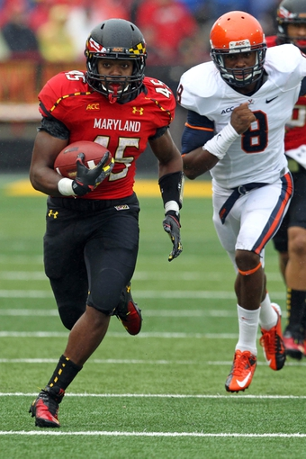 Oct 12, 2013; College Park, MD, USA; Maryland Terrapins running back Brandon Ross (45) runs past Virginia Cavaliers safety Anthony Harris (8) at Byrd Stadium. Mandatory Credit: Mitch Stringer-USA TODAY Sports