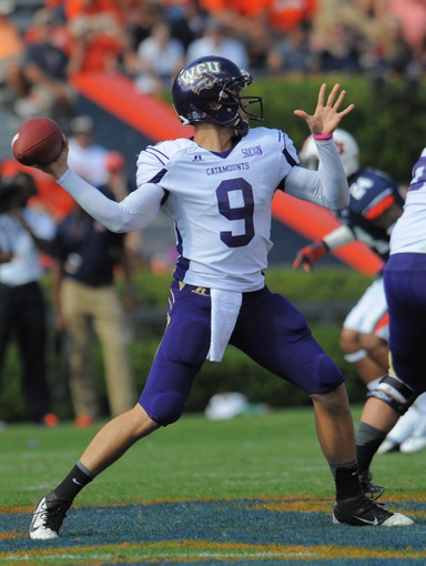 Oct 12, 2013; Auburn, AL, USA; Western Carolina Catamounts quarterback Eddie Sullivan (9) looks to pass in the second half against the Auburn Tigers at Jordan Hare Stadium. The Tigers defeated the Catamounts 62-3. Mandatory Credit: Shanna Lockwood-USA TODAY Sports