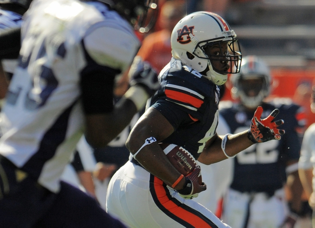 Oct 12, 2013; Auburn, AL, USA; Auburn Tigers running back Chandler Shakespeare (42) runs the ball during the second half against the Western Carolina Catamounts at Jordan Hare Stadium. The Tigers defeated the Catamounts 62-3. Mandatory Credit: Shanna Lockwood-USA TODAY Sports