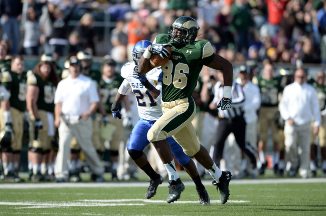 Oct 12, 2013; Fort Collins, CO, USA; Colorado State Rams tight end Kivon Cartwright (86) runs for a touchdown after a reception as San Jose State Spartans cornerback Bene Benwikere (21) chases in the second quarter Hughes Stadium. Mandatory Credit: Ron Chenoy-USA TODAY Sports