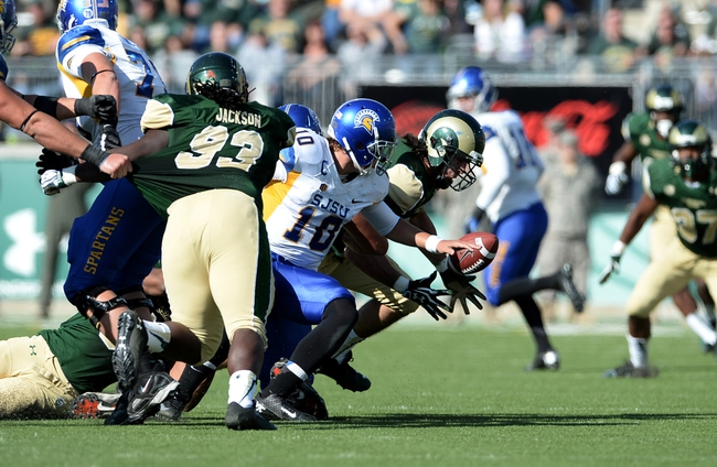 Oct 12, 2013; Fort Collins, CO, USA; San Jose State Spartans quarterback David Fales (10) fumbles the football into the hands of Colorado State Rams defensive lineman Joe Kawulok (90) in the second quarter at Hughes Stadium. Mandatory Credit: Ron Chenoy-USA TODAY Sports