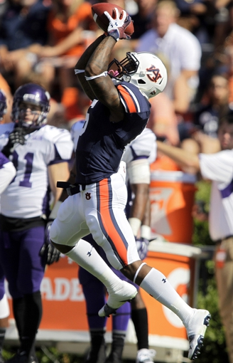Oct 12, 2013; Auburn, AL, USA; Auburn Tigers defensive back Jonthanon Mincy (6) intercepts a Western Carolina Catamounts pass during the first half at Jordan Hare Stadium.  The Tigers beat the Catamounts 62-3.  Mandatory Credit: John Reed-USA TODAY Sports