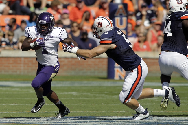 Oct 12, 2013; Auburn, AL, USA; Auburn Tigers linebacker Jake Holland (5) closes in on Western Carolina Catamounts running back Shaun Warren (1) during the first half at Jordan Hare Stadium.  The Tigers beat the Catamounts 62-3.  Mandatory Credit: John Reed-USA TODAY Sports
