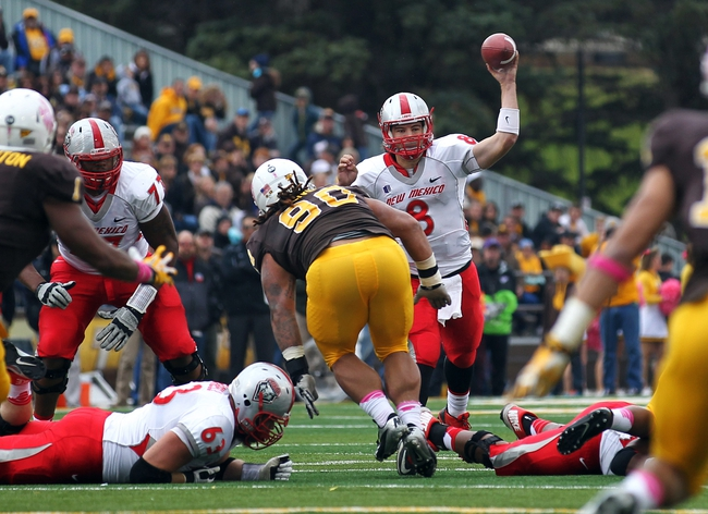 Oct 12, 2013; Laramie, WY, USA; Laramie, WY, USA; New Mexico Lobos quarterback Cole Gautsche (8) looks to pass against the Wyoming Cowboys  during the second quarter at War Memorial Stadium. Mandatory Credit: Troy Babbitt-USA TODAY Sports
