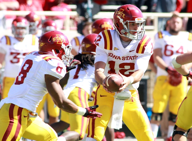 Oct 12, 2013; Lubbock, TX, USA; Iowa State Cyclones quarterback Sam B. Richardson (12) hand off to tail back James White (8) in the game with the Iowa State Cyclones at Jones AT&T Stadium. Mandatory Credit: Michael C. Johnson-USA TODAY Sports