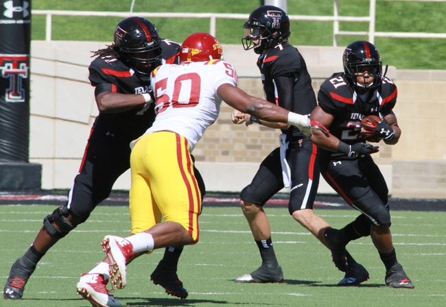 Oct 12, 2013; Lubbock, TX, USA; Texas Tech Red Raiders running back DeAndre Washington (21) rushes against the Iowa State Cyclones in the second half at Jones AT&T Stadium. Mandatory Credit: Michael C. Johnson-USA TODAY Sports