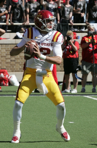 Oct 12, 2013; Lubbock, TX, USA; Iowa State Cyclones quarterback AM B. Richardson (12) passes against the Texas Tech Red Raiders in the second half at Jones AT&T Stadium. Mandatory Credit: Michael C. Johnson-USA TODAY Sports