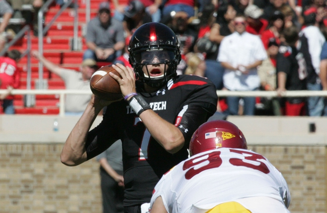 Oct 12, 2013; Lubbock, TX, USA; Texas Tech Red Raiders quarterback Davis Webb (7) looks to pass against the Iowa State Cyclones in the second half at Jones AT&T Stadium. Mandatory Credit: Michael C. Johnson-USA TODAY Sports