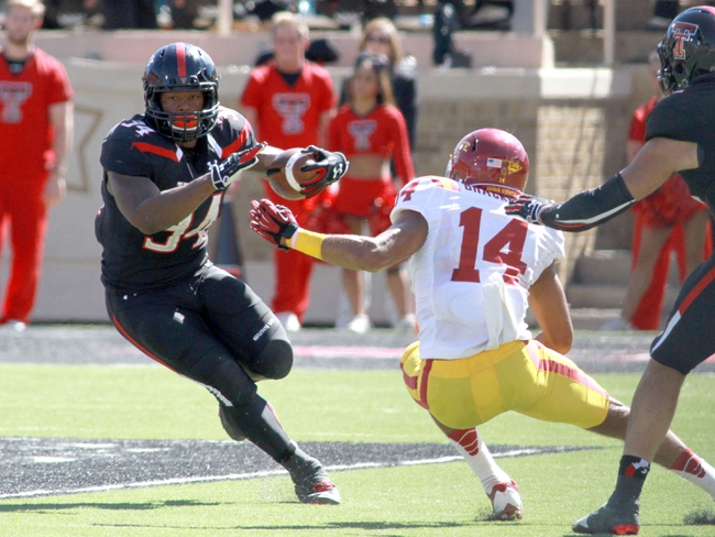 Oct 12, 2013; Lubbock, TX, USA; Texas Tech Red Raiders running back Kenny Williams (34) rushes against the Iowa State Cyclones in the second half at Jones AT&T Stadium. Mandatory Credit: Michael C. Johnson-USA TODAY Sports