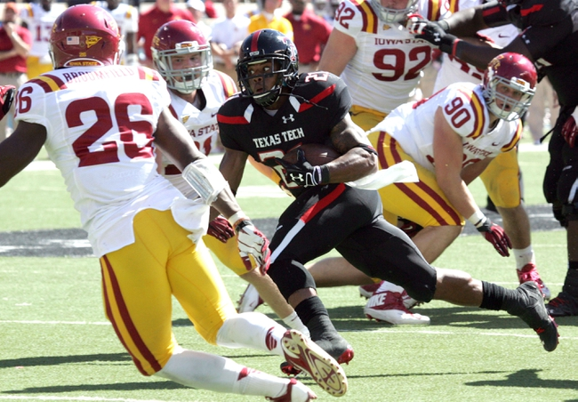 Oct 12, 2013; Lubbock, TX, USA; Texas Tech Red Raiders running back DeAndrea Washington (21) rushes against the Iowa State Cyclones in the second half at Jones AT&T Stadium. Mandatory Credit: Michael C. Johnson-USA TODAY Sports