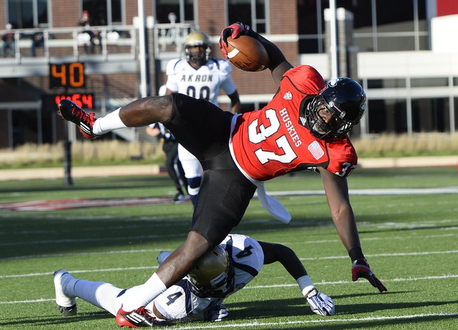 Oct 12, 2013; DeKalb, IL, USA; Northern Illinois Huskies tight end Desroy Maxwell (37) makes a catch for a touchdown against Akron Zips safety Johnny Robinson (4) during the first quarter at Huskie Stadium. Mandatory Credit: Mike DiNovo-USA TODAY Sports