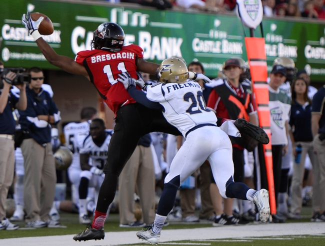 Oct 12, 2013; DeKalb, IL, USA; Northern Illinois Huskies defensive back Mycial Allen (11) makes a catch against Akron Zips cornerback Malachi Freeman (20) during the first quarter at Huskie Stadium. Mandatory Credit: Mike DiNovo-USA TODAY Sports