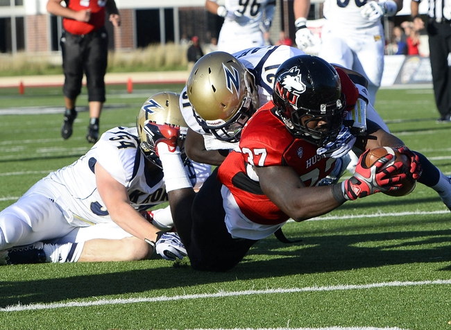 Oct 12, 2013; DeKalb, IL, USA; Northern Illinois Huskies tight end Desroy Maxwell (37) dives for the touchdown against Akron Zips cornerback Bill Alexander (21) and linebacker Dylan Evans (54) during the first quarter at Huskie Stadium. Mandatory Credit: Mike DiNovo-USA TODAY Sports
