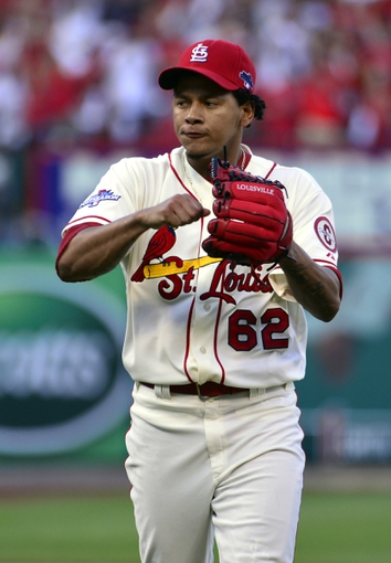 Oct 12, 2013; St. Louis, MO, USA; St. Louis Cardinals relief pitcher Carlos Martinez (62) reacts after retiring the Los Angeles Dodgers during the 8th inning in game two of the National League Championship Series baseball game at Busch Stadium. Mandatory Credit: Scott Rovak-USA TODAY Sports