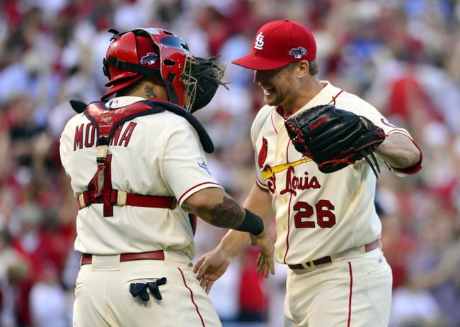 Oct 12, 2013; St. Louis, MO, USA; St. Louis Cardinals relief pitcher Trevor Rosenthal (26) celebrates with catcher Yadier Molina (4) after game two of the National League Championship Series baseball game against the Los Angeles Dodgers at Busch Stadium. Mandatory Credit: Scott Rovak-USA TODAY Sports