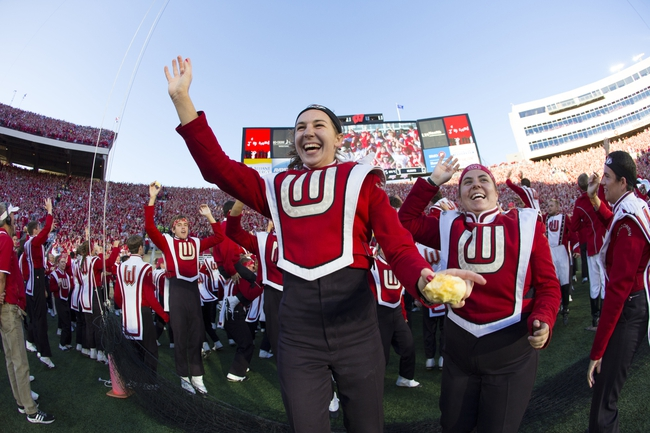 Oct 12, 2013; Madison, WI, USA; Members of the Wisconsin Badgers marching band take part in the traditional Jump Around between the third and fourth quarters against the Northwestern Wildcats at Camp Randall Stadium.  Wisconsin won 35-6.  Mandatory Credit: Jeff Hanisch-USA TODAY Sports