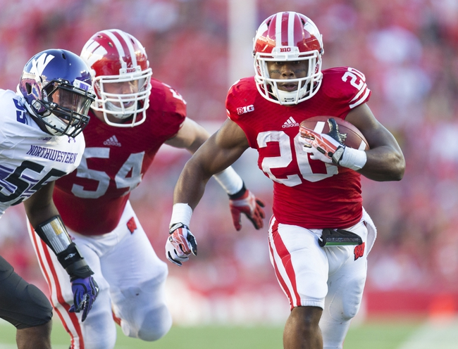 Oct 12, 2013; Madison, WI, USA; Wisconsin Badgers running back James White (20) rushes with the football during the fourth quarter against the Northwestern Wildcats at Camp Randall Stadium.  Wisconsin won 35-6.  Mandatory Credit: Jeff Hanisch-USA TODAY Sports