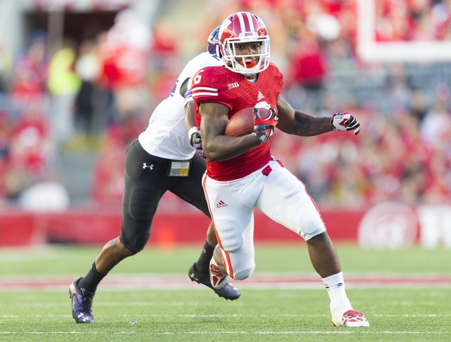 Oct 12, 2013; Madison, WI, USA; Wisconsin Badgers running back Corey Clement (6) rushes with the football during the fourth quarter against the Northwestern Wildcats at Camp Randall Stadium.  Wisconsin won 35-6.  Mandatory Credit: Jeff Hanisch-USA TODAY Sports