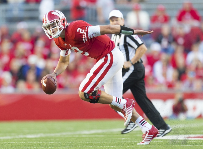 Oct 12, 2013; Madison, WI, USA; Wisconsin Badgers quarterback Joel Stave (2) scrambles out of the pocket during the fourth quarter against the Northwestern Wildcats at Camp Randall Stadium.  Wisconsin won 35-6.  Mandatory Credit: Jeff Hanisch-USA TODAY Sports