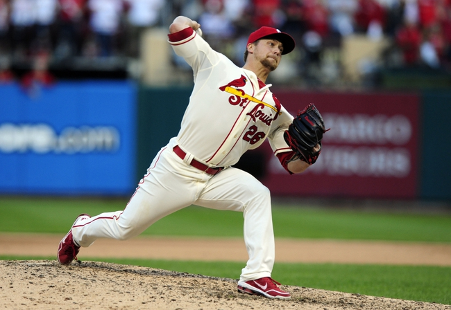 Oct 12, 2013; St. Louis, MO, USA; St. Louis Cardinals relief pitcher Trevor Rosenthal throws a pitch against the Los Angeles Dodgers during the 9th inning game two of the National League Championship Series baseball game at Busch Stadium. Mandatory Credit: Jeff Curry-USA TODAY Sports