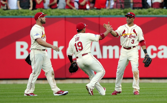 Oct 12, 2013; St. Louis, MO, USA; St. Louis Cardinals outfielders Matt Holliday (left) , Jon Jay (19) and Carlos Beltran (3) celebrate after game two of the National League Championship Series baseball game against the Los Angeles Dodgers at Busch Stadium. Mandatory Credit: Jeff Curry-USA TODAY Sports