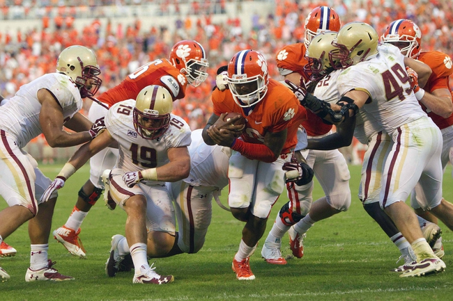 Oct 12, 2013; Clemson, SC, USA; Clemson Tigers quarterback Tajh Boyd (10) carries the ball in for a touchdown during the second half against the Boston College Eagles at Clemson Memorial Stadium. Tigers won 24-14. Mandatory Credit: Joshua S. Kelly-USA TODAY Sports