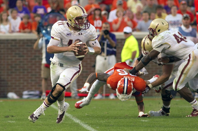 Oct 12, 2013; Clemson, SC, USA; Boston College Eagles quarterback Chase Rettig (11) looks to pass the ball during the second half against the Clemson Tigers at Clemson Memorial Stadium. Tigers won 24-14. Mandatory Credit: Joshua S. Kelly-USA TODAY Sports