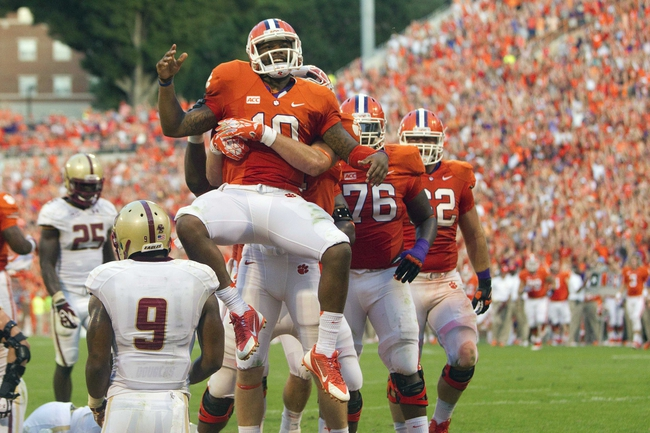 Oct 12, 2013; Clemson, SC, USA; Clemson Tigers quarterback Tajh Boyd (10) celebrates with teammates after scoring a touchdown during the second half against the Boston College Eagles at Clemson Memorial Stadium. Tigers won 24-14. Mandatory Credit: Joshua S. Kelly-USA TODAY Sports