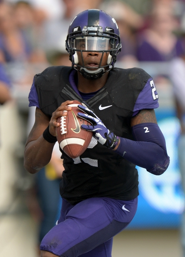 Oct 12, 2013; Fort Worth, TX, USA; TCU Horned Frogs quarterback Trevone Boykin (2) throws a pass against the Kansas Jayhawks at Amon G. Carter Stadium. Mandatory Credit: Kirby Lee-USA TODAY Sports