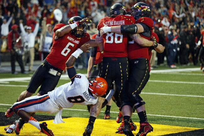 Oct 12, 2013; College Park, MD, USA; Maryland Terrapins tight end Dave Stinebaugh (86) celebrates with teammates after making the game winning catch against the Virginia Cavaliers at Byrd Stadium. Mandatory Credit: Mitch Stringer-USA TODAY Sports