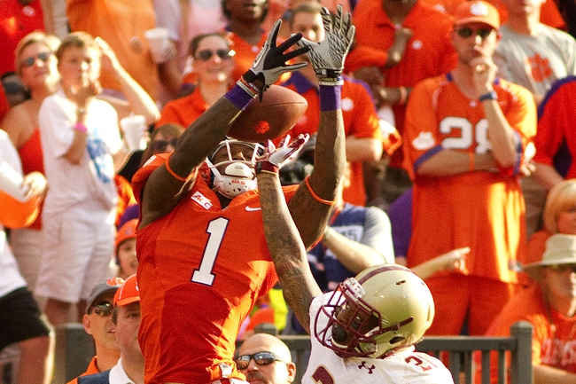 Oct 12, 2013; Clemson, SC, USA; Clemson Tigers wide receiver Martavis Bryant (1) catches the ball while being defended by Boston College Eagles defensive back Manuel Asprilla (21) during the second half at Clemson Memorial Stadium. Tigers won 24-14. Mandatory Credit: Joshua S. Kelly-USA TODAY Sports