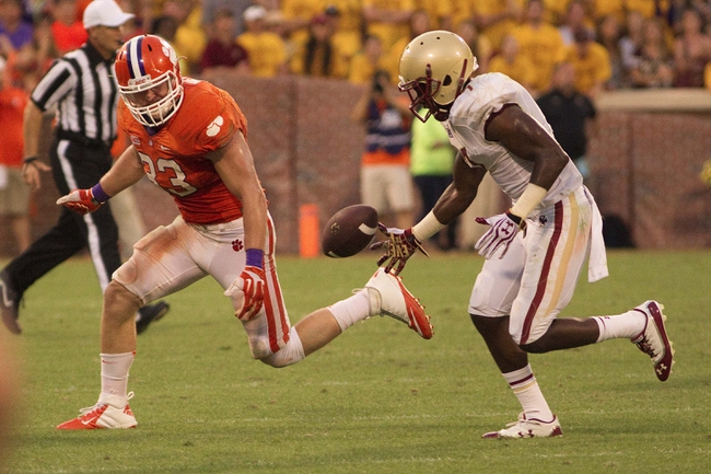 Oct 12, 2013; Clemson, SC, USA; Clemson Tigers linebacker Spencer Shuey (33) breaks up the pass indented for Boston College Eagles wide receiver Spiffy Evans (7) during the second half at Clemson Memorial Stadium. Tigers won 24-14. Mandatory Credit: Joshua S. Kelly-USA TODAY Sports
