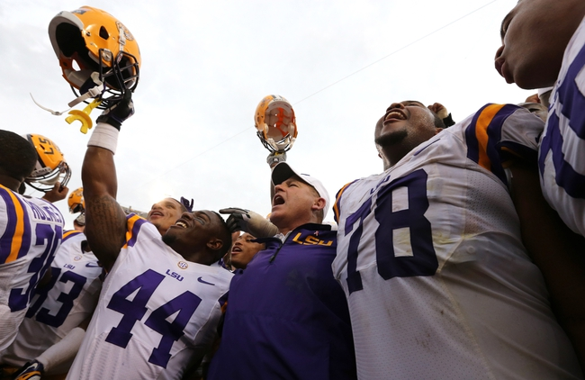 Oct 12, 2013; Baton Rouge, LA, USA; LSU Tigers head coach Les Miles sings the school alma mater with his players after his team beat the Florida Gators 17-6 at Tiger Stadium. Mandatory Credit: Chuck Cook-USA TODAY Sports