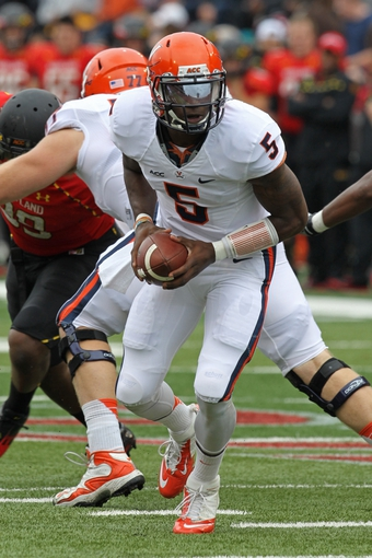 Oct 12, 2013; College Park, MD, USA; Virginia Cavaliers quarterback David Watford (5) in action against the Maryland Terrapins at Byrd Stadium. Mandatory Credit: Mitch Stringer-USA TODAY Sports