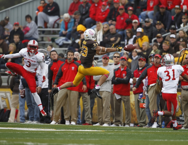 Oct 12, 2013; Laramie, WY, USA; Laramie, WY, USA; Wyoming Cowboys wide receiver Dominic Rufran (33) tries to make a reception against New Mexico Lobos cornerbacks Cranston Jones (3) and Dante Caro (31) during the second quarter at War Memorial Stadium. The Cowboys beat the Lobos 38-31. Mandatory Credit: Troy Babbitt-USA TODAY Sports
