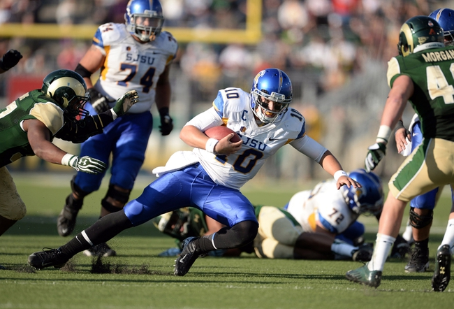 Oct 12, 2013; Fort Collins, CO, USA; San Jose State Spartans quarterback David Fales (10) runs a draw play in the third quarter against the Colorado State Rams at Hughes Stadium. The Spartans defeated the Rams 34-27. Mandatory Credit: Ron Chenoy-USA TODAY Sports
