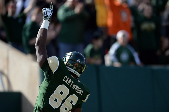 Oct 12, 2013; Fort Collins, CO, USA; Colorado State Rams tight end Kivon Cartwright (86) reacts to his touchdown reception run in the second quarter against the San Jose State Spartans at Hughes Stadium. Mandatory Credit: Ron Chenoy-USA TODAY Sports