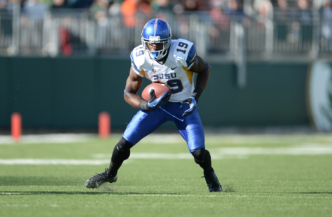 Oct 12, 2013; Fort Collins, CO, USA; San Jose State Spartans wide receiver Kyle Nunn (19) runs after a reception in the second quarter against the Colorado State Rams at Hughes Stadium. The Spartans defeated the Rams 34-27. Mandatory Credit: Ron Chenoy-USA TODAY Sports