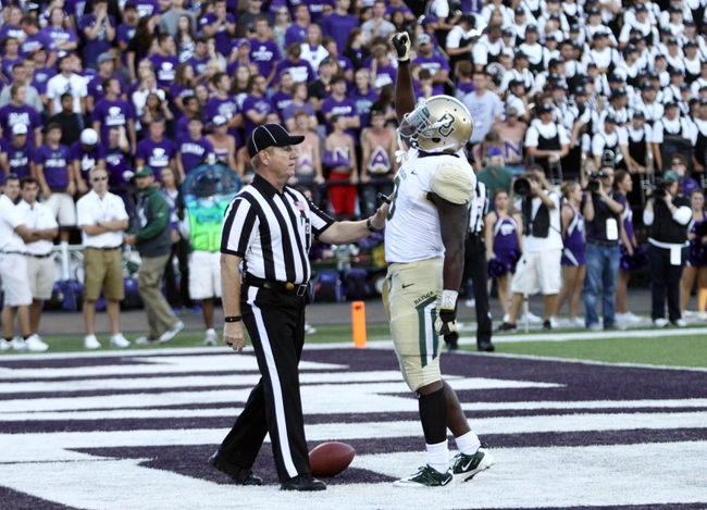 Oct 12, 2013; Manhattan, KS, USA; Baylor Bears running back Glasco Martin (8) celebrates a 21-yard touchdown run during a 35-25 win against the Kansas State Wildcats at Bill Snyder Family Stadium. Mandatory Credit: Scott Sewell-USA TODAY Sports