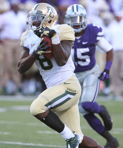 Oct 12, 2013; Manhattan, KS, USA; Baylor Bears running back Glasco Martin (8) scores a 21-yard touchdown run during a 35-25 win against the Kansas State Wildcats at Bill Snyder Family Stadium. Mandatory Credit: Scott Sewell-USA TODAY Sports