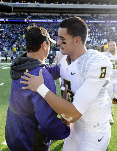 Oct 12, 2013; Seattle, WA, USA; Washington Huskies head coach Steve Sarkisian hugs Oregon Ducks quarterback Marcus Mariota (8) after the game between the Washington Huskies and the Oregon Ducks at Husky Stadium. Oregon defeated Washington 45-24. Mandatory Credit: Steven Bisig-USA TODAY Sports