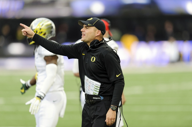 Oct 12, 2013; Seattle, WA, USA; Oregon Ducks head coach Mark Helfrich during the 2nd half against the Washington Huskies at Husky Stadium. Oregon defeated Washington 45-24. Mandatory Credit: Steven Bisig-USA TODAY Sports