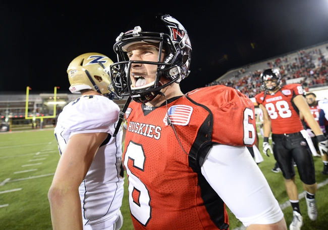 Oct 12, 2013; DeKalb, IL, USA; Northern Illinois Huskies quarterback Jordan Lynch (6) reacts after the game against the Akron Zips at Huskie Stadium. Northern Illinois defeats Akron 27-20. Mandatory Credit: Mike DiNovo-USA TODAY Sports