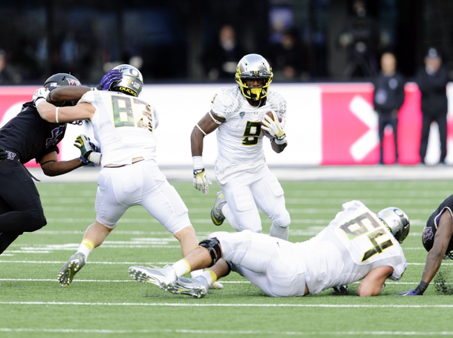 Oct 12, 2013; Seattle, WA, USA; Oregon Ducks running back Byron Marshall (9) carries the ball during the 2nd half against the Washington Huskies at Husky Stadium. Oregon defeated Washington 45-24. Mandatory Credit: Steven Bisig-USA TODAY Sports