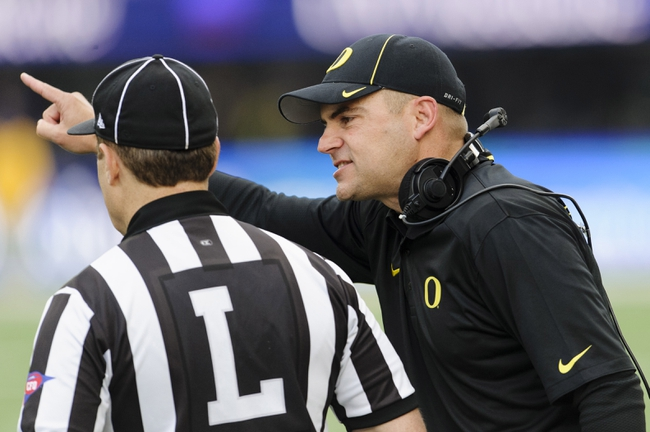 Oct 12, 2013; Seattle, WA, USA; Oregon Ducks head coach Mark Helfrich talks to the referee during the game at Husky Stadium. Oregon defeated Washington 45-24. Mandatory Credit: Steven Bisig-USA TODAY Sports