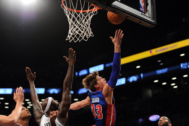 Oct 12, 2013; Brooklyn, NY, USA; Detroit Pistons power forward Jonas Jerebko (33) puts up a layup against the Brooklyn Nets during the first half of the preseason game at Barclays Center. Mandatory Credit: Joe Camporeale-USA TODAY Sports