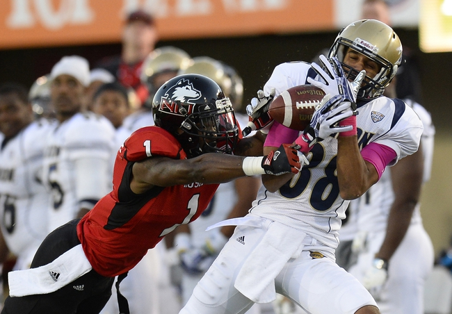 Oct 12, 2013; DeKalb, IL, USA; Northern Illinois Huskies safety Dechane Durante (1) breaks up a pass against Akron Zips wide receiver Jerrod Dillard (88) during the second half at Huskie Stadium. Northern Illinois defeats Akron 27-20. Mandatory Credit: Mike DiNovo-USA TODAY Sports
